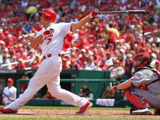 ST. LOUIS, MO - APRIL 19: Matt Holliday #7 of the St. Louis Cardinals hits a three-run home run against the Cincinnati Reds at Busch Stadium on April 19, 2012 in St. Louis, Missouri. The Reds defeated the Cardinals 6-3.  (Photo by Dilip Vishwanat/Getty Images)