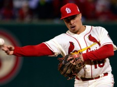 Oct 26, 2013; St. Louis, MO, USA; St. Louis Cardinals second baseman Kolten Wong throws to first base in the 8th inning against the Boston Red Sox during game three of the MLB baseball World Series at Busch Stadium. Mandatory Credit: Scott Rovak-USA TODAY Sports