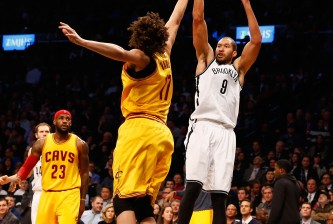 NEW YORK, NY - DECEMBER 08:  Jerome Jordan #9 of the Brooklyn Nets shoots against Anderson Varejao #17 of the Cleveland Cavaliers during their game at the Barclays Center on December 8, 2014 in New York City. NOTE TO USER: User expressly acknowledges and agrees that, by downloading and or using this photograph, User is consenting to the terms and conditions of the Getty Images License Agreement.  (Photo by Al Bello/Getty Images)