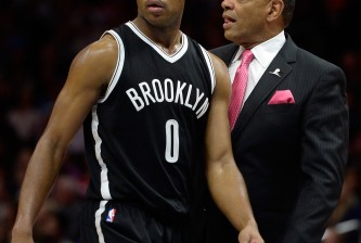 LOS ANGELES, CA - JANUARY 22:  Jarrett Jack #0 of the Brooklyn Nets and Lionel Hollins react for a foul during the first half against the Los Angeles Clippers at Staples Center on January 22, 2015 in Los Angeles, California.   NOTE TO USER: User expressly acknowledges and agrees that, by downloading and or using this Photograph, user is consenting to the terms and condition of the Getty Images License Agreement.  (Photo by Harry How/Getty Images)