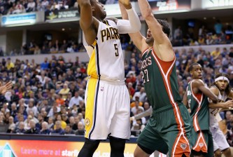INDIANAPOLIS, IN - NOVEMBER 04:  Zaza Pachulia #27 of the Milwaukee Bucks defends Lavoy Allen #5 of the Indiana Pacers during the game at Bankers Life Fieldhouse on November 4, 2014 in Indianapolis, Indiana.  (Photo by Andy Lyons/Getty Images)