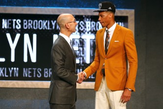 NEW YORK, NY - JUNE 25:  Chris McCullough meets Commissioner Adam Silver after being selected 29th overall by the Brooklyn Nets in the First Round of the 2015 NBA Draft at the Barclays Center on June 25, 2015 in the Brooklyn borough of  New York City. NOTE TO USER: User expressly acknowledges and agrees that, by downloading and or using this photograph, User is consenting to the terms and conditions of the Getty Images License Agreement.  (Photo by Elsa/Getty Images)