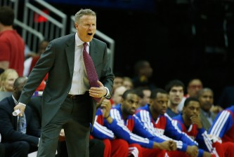 HOUSTON, TX - MARCH 27:  Head coach Brett Brown of the Philadelphia 76ers reacts to a play during the game against the Houston Rockets at the Toyota Center on March 27, 2014 in Houston, Texas. NOTE TO USER: User expressly acknowledges and agrees that, by downloading and or using this photograph, User is consenting to the terms and conditions of the Getty Images License Agreement.  (Photo by Scott Halleran/Getty Images)