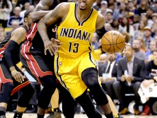 INDIANAPOLIS, IN - APRIL 05:  Paul George #13 of the Indiana Pacers dribbles the ball against the Miami Heat at Bankers Life Fieldhouse on April 5, 2015 in Indianapolis, Indiana.  Tonight is his first game this season .  NOTE TO USER: User expressly acknowledges and agrees that, by downloading and or using this photograph, User is consenting to the terms and conditions of the Getty Images License Agreement.  (Photo by Andy Lyons/Getty Images)