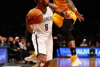 NEW YORK, NY - MARCH 24:  Sean Kilpatrick #6 of the Brooklyn Nets in action against Iman Shumpert #4 of the Cleveland Cavaliers during their game at the Barclays Center on March 24, 2016 in New York City.   NOTE TO USER: User expressly acknowledges and agrees that, by downloading and/or using this Photograph, user is consenting to the terms and conditions of the Getty Images License Agreement.  (Photo by Al Bello/Getty Images)