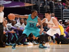 LOS ANGELES, CA - NOVEMBER 9:  Kemba Walker #15 of the Charlotte Hornets handles the ball against Jeremy Lin #17 of the Los Angeles Lakers on November 9, 2014 at Staples Center in Los Angeles, California. NOTE TO USER: User expressly acknowledges and agrees that, by downloading and or using this Photograph, user is consenting to the terms and conditions of the Getty Images License Agreement. Mandatory Copyright Notice: Copyright 2014 NBAE (Photo by Andrew D. Bernstein/NBAE via Getty Images)