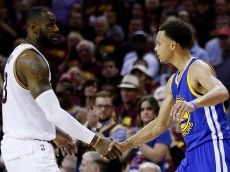 CLEVELAND, OH - JUNE 16:  LeBron James #23 of the Cleveland Cavaliers shakes hands with Stephen Curry #30 of the Golden State Warriors after the Warriors defeated the Cavs 105 to 97 to win Game Six of the 2015 NBA Finals at Quicken Loans Arena on June 16, 2015 in Cleveland, Ohio. NOTE TO USER: User expressly acknowledges and agrees that, by downloading and or using this photograph, user is consenting to the terms and conditions of Getty Images License Agreement.  (Photo by Ezra Shaw/Getty Images)