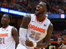 SYRACUSE, NY - JANUARY 13:  Rakeem Christmas #25 of the Syracuse Orange reacts to a made basket and a foul against the Wake Forest Demon Deacons during the second half at the Carrier Dome on January 13, 2015 in Syracuse, New York.  Syracuse defeated Wake Forest 86-83 in overtime.  (Photo by Rich Barnes/Getty Images)