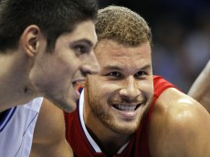 Los Angeles Clippers forward Blake Griffin (32) and guard Jared Cunningham (9) smile while on the baseline during a foul during the second quarter at Amway Center. Mandatory Credit: Kim Klement-USA TODAY Sports