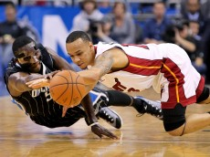 Orlando Magic guard Victor Oladipo, left,and Miami Heat guard Shabazz Napier fight for the ball during the first quarter of an NBA basketball game at Amway Center. Mandatory Credit: Reinhold Matay-USA TODAY Sports