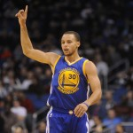 Golden State Warriors guard Stephen Curry (30) celebrates a three-point basket against the Orlando Magic in the first quarter at Amway Center. Mandatory Credit: David Manning-USA TODAY Sports