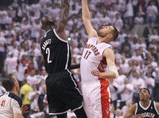 Kevin Garnett & Jonas Valanciunas battle for the opening jump ball in Game 1, Round One, 2014 NBA Playoffs.  Photo credit: NBAE/Getty Images