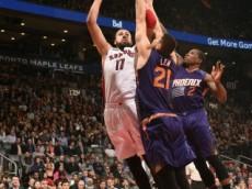 Raptors' Valanciunas shoots over Suns' Len & Bledsoe