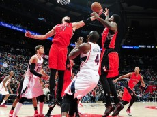Raptors' Jonas Valanciunas & Amir Johnson work for the rebound