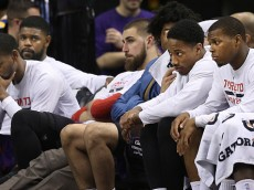 Toronto, Canada - February 27  -  In second half action as the clock winds down, the Raptors bench looks very glum. The Toronto Raptors took  lost to the top ranked Golden State Warriors 113-89 at the Air Canada Centre in NBA action. February 27, 2015        (Richard Lautens/Toronto Star via Getty Images)