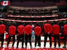 TORONTO, ON - OCTOBER 28:  The Toronto Raptors line up for the national anthems prior to the NBA season opener against the Indiana Pacers at Air Canada Centre on October 28, 2015 in Toronto, Ontario, Canada.  NOTE TO USER: User expressly acknowledges and agrees that, by downloading and or using this photograph, User is consenting to the terms and conditions of the Getty Images License Agreement.  (Photo by Vaughn Ridley/Getty Images)