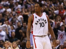 TORONTO, ON - OCTOBER 28:  DeMar DeRozan #10 of the Toronto Raptors reacts to a call by the referee during the NBA season opener against the Indiana Pacers at Air Canada Centre on October 28, 2015 in Toronto, Ontario, Canada.  NOTE TO USER: User expressly acknowledges and agrees that, by downloading and or using this photograph, User is consenting to the terms and conditions of the Getty Images License Agreement.  (Photo by Vaughn Ridley/Getty Images)