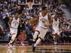 TORONTO, ON - DECEMBER 09:  DeMar DeRozan #10 of the Toronto Raptors dribbles the ball during an NBA game against the San Antonio Spurs at the Air Canada Centre on December 09, 2015 in Toronto, Ontario, Canada.  NOTE TO USER: User expressly acknowledges and agrees that, by downloading and or using this photograph, User is consenting to the terms and conditions of the Getty Images License Agreement.  (Photo by Vaughn Ridley/Getty Images)