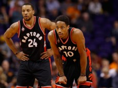 PHOENIX, AZ - FEBRUARY 02:  (R-L) DeMar DeRozan #10 and Norman Powell #24 of the Toronto Raptors look down court during the first half of the NBA game against the Phoenix Suns at Talking Stick Resort Arena on February 2, 2016 in Phoenix, Arizona.  NOTE TO USER: User expressly acknowledges and agrees that, by downloading and or using this photograph, User is consenting to the terms and conditions of the Getty Images License Agreement.  (Photo by Christian Petersen/Getty Images)