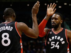 PHOENIX, AZ - FEBRUARY 02:  Patrick Patterson #54 of the Toronto Raptors high fives Bismack Biyombo #8 during the first half of the NBA game against the Phoenix Suns at Talking Stick Resort Arena on February 2, 2016 in Phoenix, Arizona.  NOTE TO USER: User expressly acknowledges and agrees that, by downloading and or using this photograph, User is consenting to the terms and conditions of the Getty Images License Agreement.  (Photo by Christian Petersen/Getty Images)