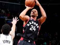 Norman Powell (Toronto Raptors) rises up to shoot over  Shane Larkin (Brooklyn Nets) April 13, 2016 (via NBA.com).