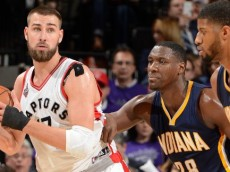 Jonas Valancinuas (Toronto Raptors) looks to make a play with Ian Mahinmi and Paul George (Indiana Pacers) defending him. April 18, 2016 (via NBA.com)