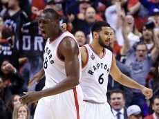 TORONTO, ON - APRIL 26:  Bismack Biyombo #8 and Cory Joseph #6 of the Toronto Raptors celebrate a basket against the Indiana Pacers in the first half of Game Five of the Eastern Conference Quarterfinals during the 2016 NBA Playoffs at the Air Canada Centre on April 26, 2016 in Toronto, Ontario, Canada.  NOTE TO USER: User expressly acknowledges and agrees that, by downloading and or using this photograph, User is consenting to the terms and conditions of the Getty Images License Agreement.  (Photo by Vaughn Ridley/Getty Images)
