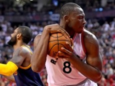 May 21, 2016; Toronto, Ontario, CAN;   Toronto Raptors center Bismack Biyombo (8) clutches the ball after making a rebound in the second half of a 99-84 win over Cleveland Cavaliers in game three of the Eastern conference finals of the NBA Playoffs at Air Canada Centre. Mandatory Credit: Dan Hamilton-USA TODAY Sports