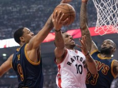 DeMar DeRozan, Toronto Raptors, attacks the rim against  Channing Frye and LeBron James of the Cleveland Cavaliers Game 4, 2016 NBA Eastern Conference Finals. May 23, 2016 (Photo via NBA.com) (c) Nick Turchiaro