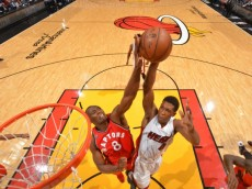 MIAMI,FL - MAY 13 : Bismack Biyombo #8 of the Toronto Raptors blocks the shot against the Miami Heat during the Eastern Conference playoffs Semifinals Game Six on May 13, 2016 at the American Airlines Arena in Miami, Florida. Jesse D. Garrabrant/NBAE via Getty Images