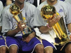 kobe_bryant_holding_nba_finals_mvp_trophy_while_derek_fisher_holds_the_championship_trophy