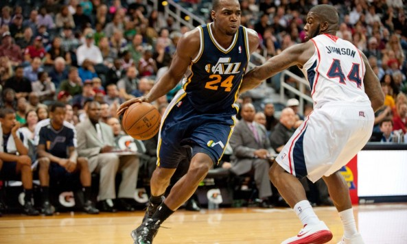 Paul Millsap drives by Ivan Johnson