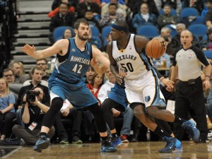 Memphis Grizzlies' Zach Ranolph is guarded by Minnesota Timberwolves' Kevin Love