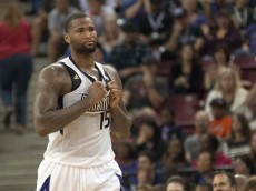 demarcus cousins pulls on jersey after getting t'd up