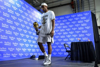 kawhi leonard with mvp trophy press conference