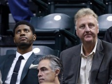 paul george & larry bird sitting in the stands