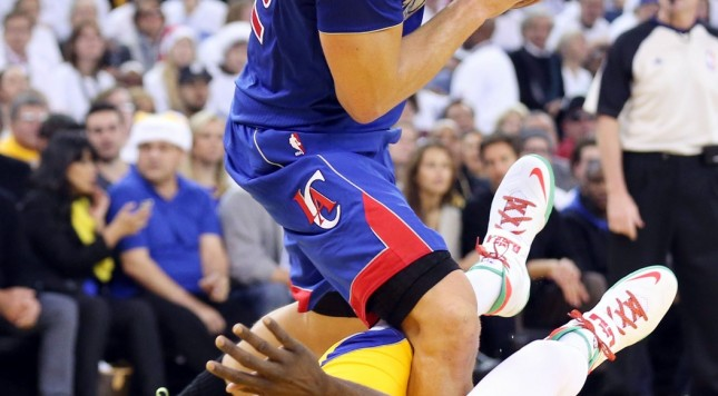 draymond green takes a charge from blake griffin
