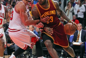 lebron james dribbles past joakim noah
