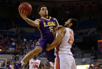 GAINESVILLE, FL - JANUARY 20:  Josh Gray #5 of the LSU Tigers drives as Jon Horford #21 of the Florida Gators defends during the first half of the game at Stephen C. O'Connell Center on January 20, 2015 in Gainesville, Florida.  (Photo by Rob Foldy/Getty Images)