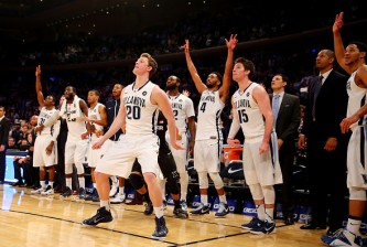 NEW YORK, NY - MARCH 14: The Villanova Wildcats bench reacts after a shot by Patrick Farrell #20 of the Villanova Wildcats against the Xavier Musketeers during the championship game of the Big East basketball tournament at Madison Square Garden on March 14, 2015 in New York City.  (Photo by Elsa/Getty Images)