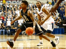 STORRS, CT - JANUARY 22: Brandon Goodwin #11 of the Central Florida Knights drives past Rodney Purvis #44 of the Connecticut Huskies in the first half during the game at Harry A. Gampel Pavilion on January 22, 2015 in Storrs, Connecticut.  (Photo by Jared Wickerham/Getty Images)