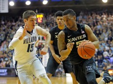 VILLANOVA, PA - DECEMBER 31: Trevon Bluiett #5 of the Xavier Musketeers dribbles the ball as Ryan Arcidiacono #15 of the Villanova Wildcats defends during a game at the Pavilion on the campus of Villanova University on December 31, 2015 in Philadelphia, Pennsylvania. Villanova won 95-64. (Photo by Hunter Martin/Getty Images)