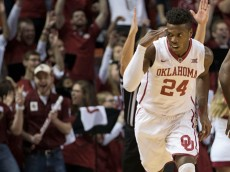 NORMAN, OK - JANUARY 16: Buddy Hield #24 of the Oklahoma Sooners reacts after making his first two point shot against West Virginia during the first half of a NCAA college basketball game at the Lloyd Noble Center on January 16, 2016 in Norman, Oklahoma. (Photo by J Pat Carter/Getty Images)