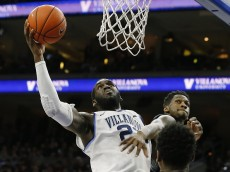 PHILADELPHIA, PA - MARCH 5: Daniel Ochefu #23 of the Villanova Wildcats attempts a shot as L.J. Peak #0 of the Georgetown Hoyas defends during the second half in an NCAA college basketball game on March 5, 2016 at the Wells Fargo Center in Philadelphia, Pennsylvania. Villanova defeated Georgetown 84-71. (Photo by Rich Schultz /Getty Images)