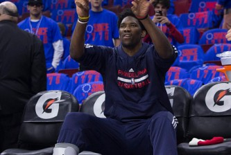 PHILADELPHIA, PA - OCTOBER 30: Joel Embiid #21 of the Philadelphia 76ers takes a shot from the bench prior to the game against the Utah Jazz on October 30, 2015 at the Wells Fargo Center in Philadelphia, Pennsylvania. NOTE TO USER: User expressly acknowledges and agrees that, by downloading and or using this photograph, User is consenting to the terms and conditions of the Getty Images License Agreement. (Photo by Mitchell Leff/Getty Images)