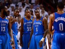 MIAMI, FL - JUNE 21: (L-R) James Harden #13, Serge Ibaka #9, Kevin Durant #35, Kendrick Perkins #5 and Russell Westbrook #0 of the Oklahoma City Thunder stand on court against the Miami Heat  in Game Five of the 2012 NBA Finals on June 21, 2012 at American Airlines Arena in Miami, Florida. NOTE TO USER: User expressly acknowledges and agrees that, by downloading and or using this photograph, User is consenting to the terms and conditions of the Getty Images License Agreement.  (Photo by Ronald Martinez/Getty Images)