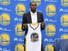 OAKLAND, CA - JULY 07:  Kevin Durant #35 of the Golden State Warriors poses with his new jersey during the press conference where he was introduced as a member of the Golden State Warriors after they signed him as a free agent on July 7, 2016 in Oakland, California.  (Photo by Thearon W. Henderson/Getty Images)