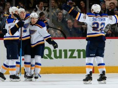 DENVER, CO - DECEMBER 13:  T.J. Oshie #74 of the St. Louis Blues celebrates his game winning goal in overtime against the Colorado Avalanche with teammates Barret Jackman #5, Jaden Schwartz #17 and Kevin Shattenkirk #22 of the St. Louis Blues at Pepsi Center on December 13, 2014 in Denver, Colorado. The Blues defeated the Avalanche 3-2 in overtime.  (Photo by Doug Pensinger/Getty Images)