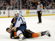 ANAHEIM, CA - JANUARY 02:  Ryan Reaves #75 of the St. Louis Blues fights Clayton Stoner #3 of the Anaheim Ducks to the ice during the first period at Honda Center on January 2, 2015 in Anaheim, California.  (Photo by Harry How/Getty Images)
