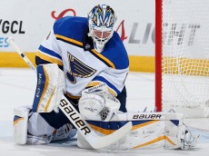 GLENDALE, AZ - JANUARY 06:  Goaltender Brian Elliott #1 of the St. Louis Blues makes a glove save on a shot from the Arizona Coyotes during the first period of the NHL game at Gila River Arena on January 6, 2015 in Glendale, Arizona.  (Photo by Christian Petersen/Getty Images)